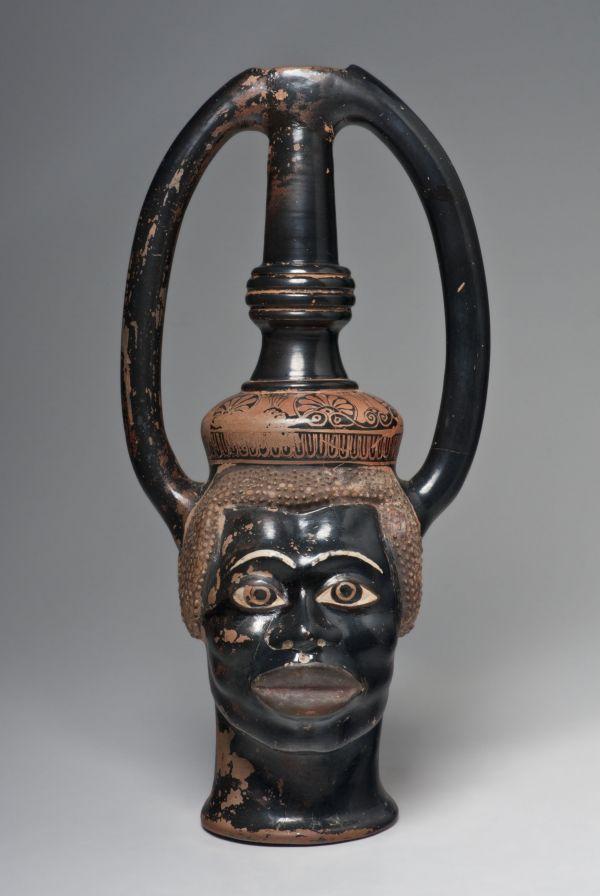 Bild Der Weinheber aus Athen füllt sich durch Löcher im Boden und entleert sich bei Öffnung des Griffloches. Um 490 v. Chr.