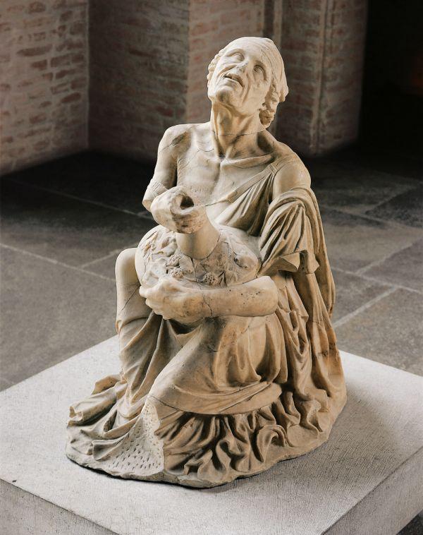 Bild Die sogenannte Trunkene Alte ist die Statue einer vom Wein berauschten, am Boden kauernden alten Frau aus der Zeit um 200 v. Chr.