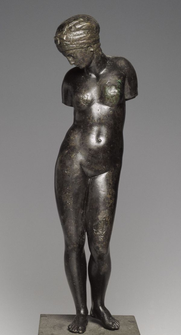 Image Aphrodite, goddess of beauty and love, has got out of the bath and perhaps held a mirror in her hand in which she 	looks at herself. Bronze statuette, 120–100 B.C.