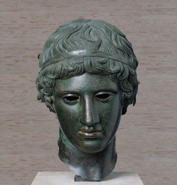 Image Eyeballs of silver and pupils of red garnet are lost. Roman bronze after a Classical Greek model around 450 B.C.
